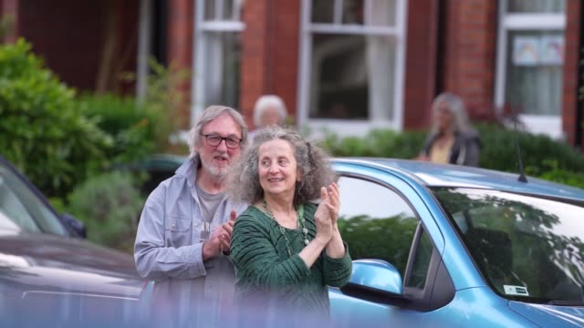 slomo residents of park avenue north n8 in crouch end come out every thursday to sing 'lean on me' by bill withers on may 7th 2020 in london england... - emergence stock videos & royalty-free footage