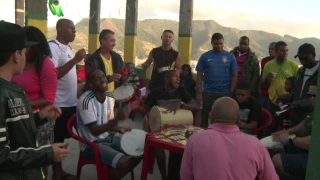 residents of rio de janeiros mangueira favela which overlooks the maracana stadium took a look back over brazils world cup as they watched the final... - sportweltmeisterschaft stock-videos und b-roll-filmmaterial