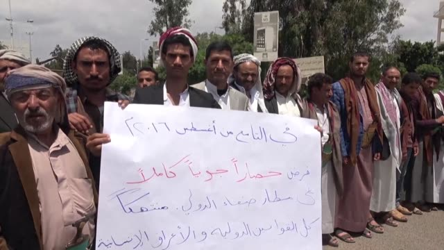 residents of sanaa protest in front of the capital's airport demanding the lifting of the siege on the airport - yemen stock videos & royalty-free footage
