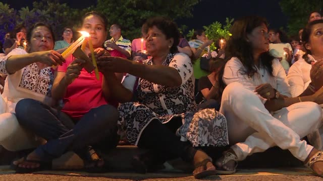 Residents of Sri Lanka's capital Colombo protest silently with candles to express their anger at the President's recent decisions to dissolve...