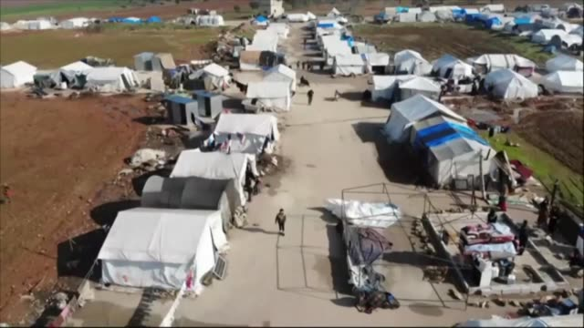 vídeos y material grabado en eventos de stock de resident's of syria's last major opposition bastion welcome a un vote renewing cross border aid to the country as relief groups condemned... - caridad y auxilio