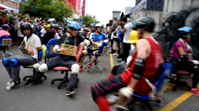residents of tainan in southern taiwan got to enjoy a spectacle on april 24 as contestants careened around tight turns in a race of caster-equipped... - office chair stock videos & royalty-free footage