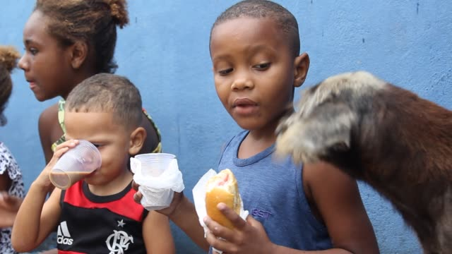 residents of the cidade de deus community receive food donations amidst the coronavirus pandemic on may 23 2020 in rio de janeiro brazil the... - cidade stock videos & royalty-free footage