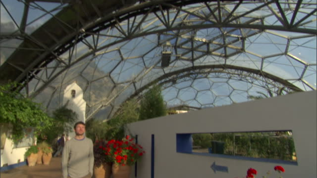 residents of the eden project walk inside its biodomes. - civilian stock videos & royalty-free footage
