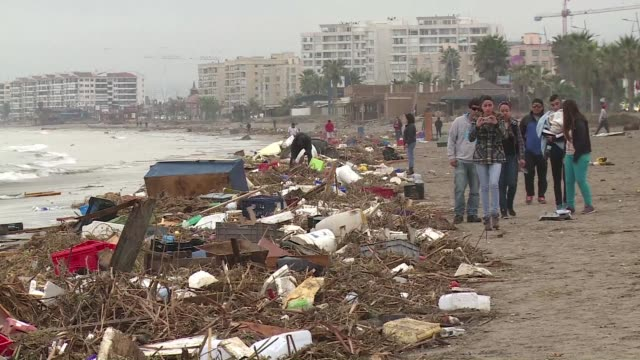 Residents of the touristic town of La Serena continue cleaning up debris after tsunami waves crashed into their homes causing heavy damage and...