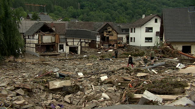 residents of the village of schuld, west germany, looking through rubble after flash flooding, triggered by heavy rainfall, devastated their village - germany stock videos & royalty-free footage