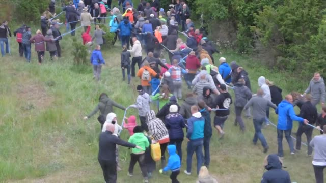 residents on estonia's two biggest islands took their age old rivalry to a whole new level this weekend by staging their first tug of war using a 10... - kilometre stock videos & royalty-free footage