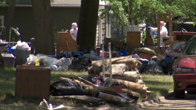 residents pick through rubble after a flood. - rubble stock-videos und b-roll-filmmaterial
