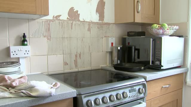 residents say nothing changed after itv news exposed terrible croydon housing conditions; england: london: croydon: int hawar yousif set up shot with... - wet stock videos & royalty-free footage
