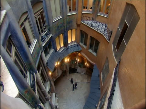 Residents stand in the courtyard of La Pedrera.