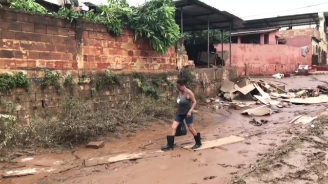 residents survey the damage to their neighbourhoods and homes in sabara in southeastern brazil after floods and record rains killed at least 45... - south america stock videos & royalty-free footage