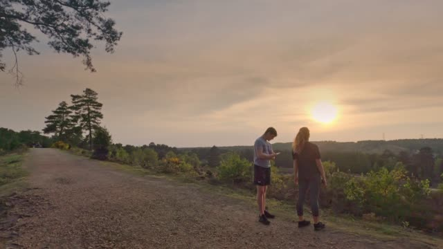residents take a walk just before sunset during the coronavirus pandemic on april 23, 2020 in camberley, england. the british government has extended... - sunset stock videos & royalty-free footage