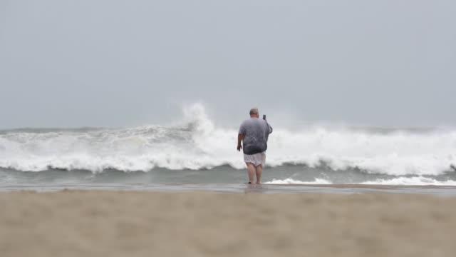 residents visit the beach around sunrise ahead of the arrival of hurricane florence september 13 2018 in atlantic beach north carolina - atlantic beach north carolina stock videos & royalty-free footage