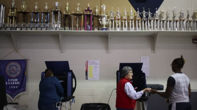 vídeos de stock, filmes e b-roll de residents vote in the south carolina democratic presidential primary election at a polling station inside spartanburg high school in spartanburg... - primary election