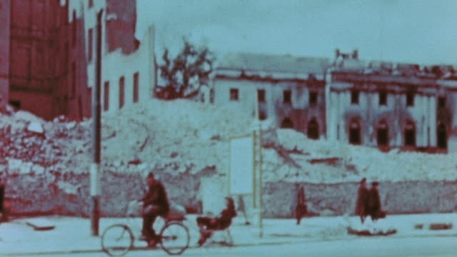 residents walking past bombed out buildings and rubble on city streets, and children playing on the sidewalk / berlin, germany - rubble stock videos & royalty-free footage