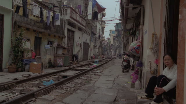 residents watch for the next train to pass through their neighborhood. - vietnam stock videos & royalty-free footage