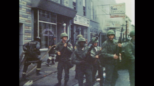 residents watch soldiers guard and firefighters work to put out fires in the wake of baltimore riots - 1968 stock videos & royalty-free footage
