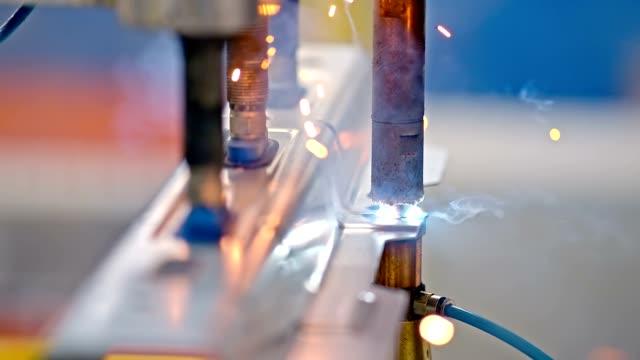 SLO MO Resistance welder welding a nut