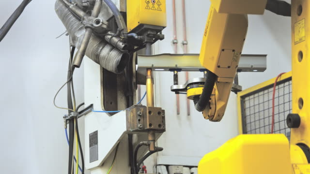 slo mo resistance welder welding a piece of metal - azionare video stock e b–roll