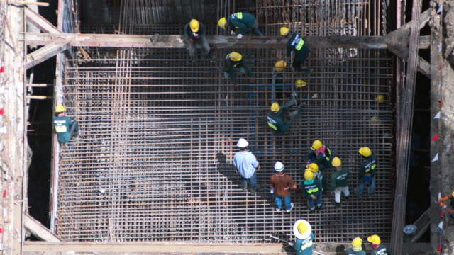 4k resolution aerial time-lapse: working in construction site in bangkok thailand - surveyor stock videos & royalty-free footage