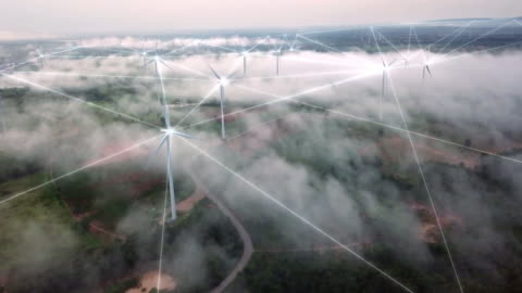 4k resolution aerial view of connection technology with wind turbine field on fog and mist over landscape,wind power and alternative energy concept - turbine stock videos & royalty-free footage