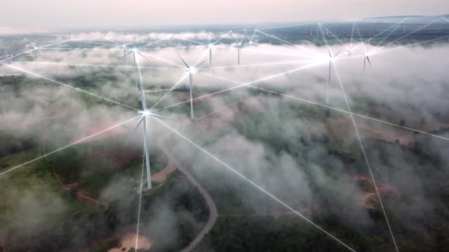 4k resolution aerial view of connection technology with wind turbine field on fog and mist over landscape,wind power and alternative energy concept - smart stock videos & royalty-free footage