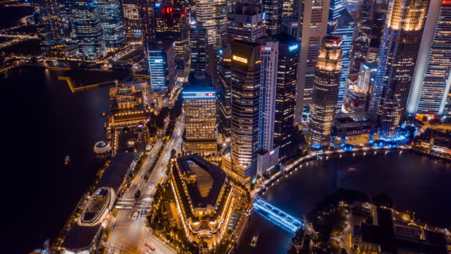 vídeos de stock e filmes b-roll de 4k resolution aerial view time lapse of singapore skyscraper business district and modern building exterior,drone point of view,directly above background,asian famous place,tourist attraction landmark, asian city lifestyle - singapura