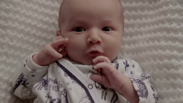 4k resolution - angry baby face, portrait of cute infant emotion, funny childhood. - close to stock videos & royalty-free footage
