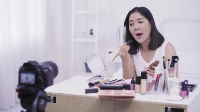 4k resolution asian woman beauty blogger,v-logger applying blush to her face cosmetic makeup tutorial - tutorial stock videos and b-roll footage