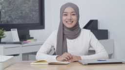 4K Resolution beautiful Asian Muslim woman talking to camera,attractive Asian Muslim woman smiling Video Conference,Modern Muslim Woman from the South East and East Asian region lifestyle Concept