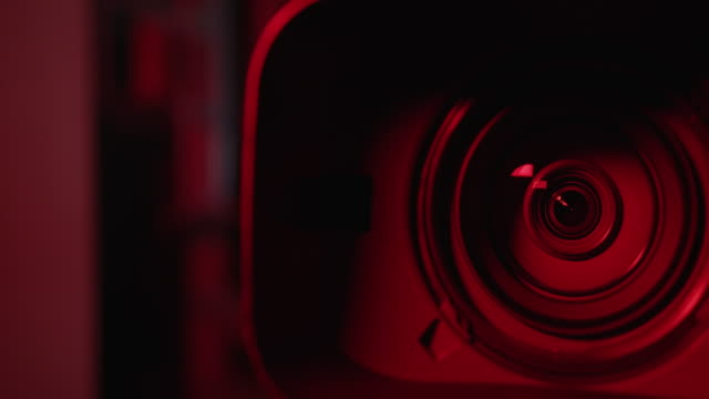 4k resolution camera and lens zoom, close-up to the lens. emergency light. - film camera stock videos & royalty-free footage