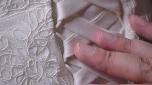 4k resolution close up the dressmaker is sewing the wedding dress. - white dress stock videos & royalty-free footage