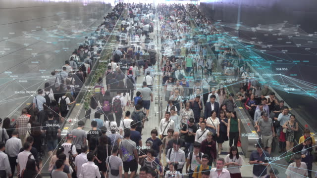4k resolution networking connection and communication concept with crowd commuters of pedestrian commuters on train station at hong kong station.internet of thing and big data concept - binary code stock videos & royalty-free footage