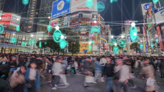 4k resolution people and technology concept,global communication icon with network connections line above crowded people walking .internet of things and smart city concept,technology-futuristic concept - japan stock videos & royalty-free footage