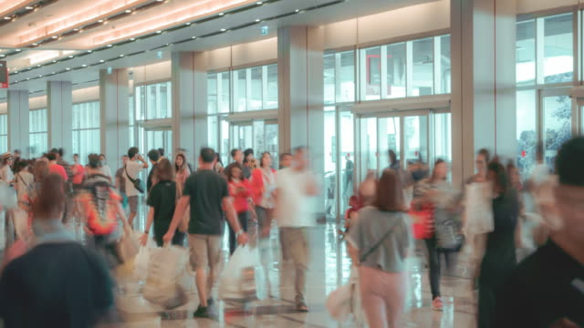 4k resolution time lapse crowd in trade event exhibition hall. business trade show,shopping mall and marketing advertisement concept,mice industry business concept - trade show stock videos and b-roll footage