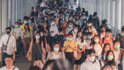 4K resolution Time lapse  crowds of Asian people wearing face protection in prevention for Coronavirus or Covid-19 and micro dust pm 2.5 in air while going to their workplace in Bangkok at morning rush hour