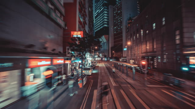 4k resolution time lapse on tram fast speed motion in hong kong city,hong kong business and transportation concept - central district hong kong stock videos & royalty-free footage