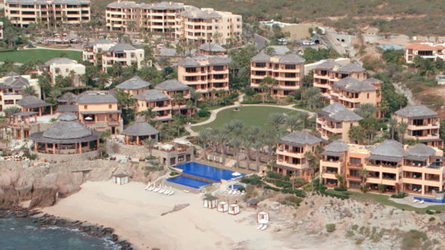 resort hotels line the beaches on the coast of mexico. - cabo san lucas stock videos & royalty-free footage