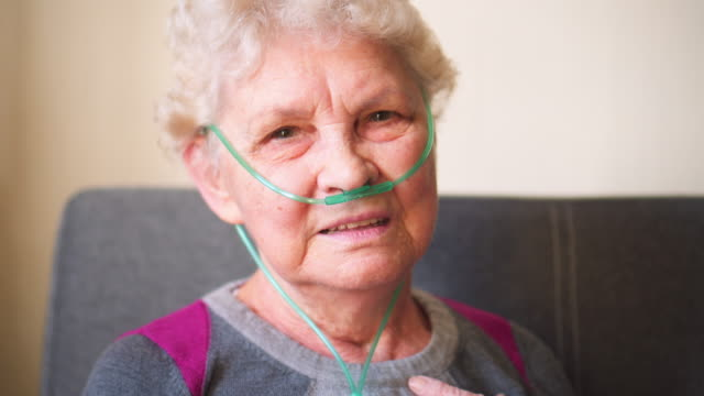 respiratory oxygen nasal catheter to senior woman - oxygen stock videos & royalty-free footage