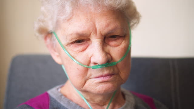 respiratory oxygen nasal catheter to senior woman - lung stock videos and b-roll footage