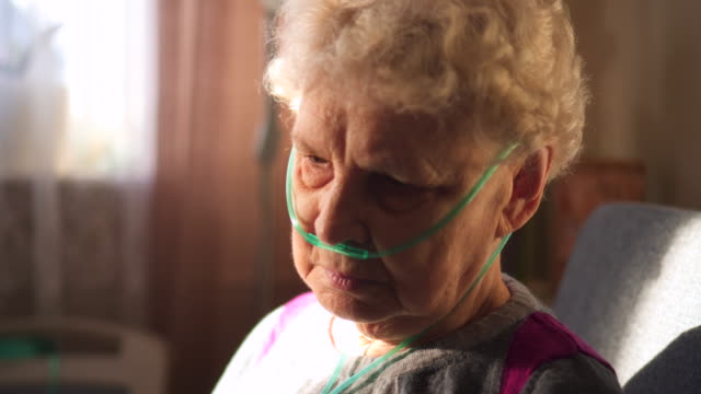 respiratory oxygen nasal catheter to senior woman - asthmatic stock videos and b-roll footage