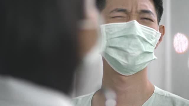 respiratory system - asian man coughing stock videos & royalty-free footage