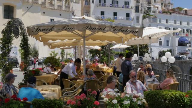 restaurant along the promenade, amalfi, costiera amalfitana (amalfi coast), unesco world heritage site, campania, italy, europe - amalfi stock videos and b-roll footage