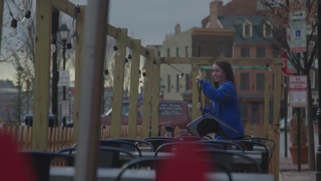 restaurant employees sets out chairs for outdoor dining during the coronavirus pandemic on january 22, 2020 in baltimore, maryland. the city lifted... - bright colour stock videos & royalty-free footage