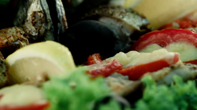 Restaurant food. Grilled fish and vegetables