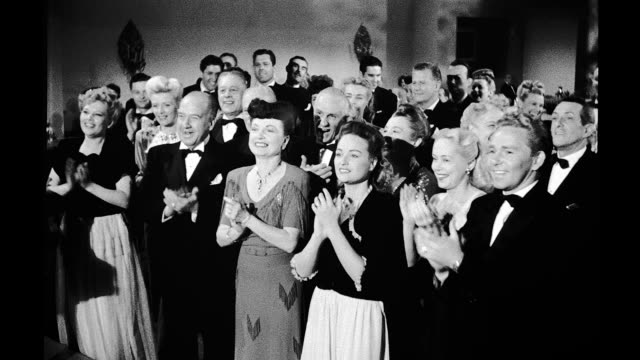 1945, restaurant, formally dressed people standing and clapping