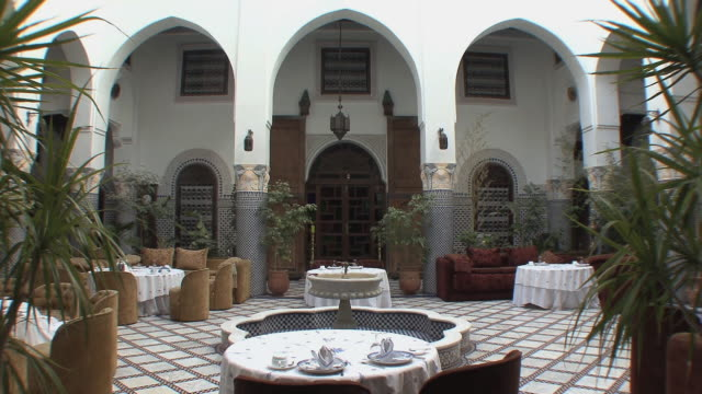 ws tu restaurant in riad, traditional moroccan palace, fez, morocco - moroccan culture stock videos & royalty-free footage
