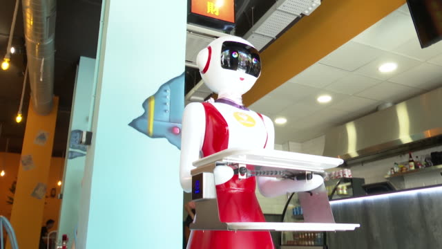 a restaurant in valencia becomes the first in the region to have robots as waiters the robots of the crensa restaurant are in charge of serving the... - robot stock videos & royalty-free footage