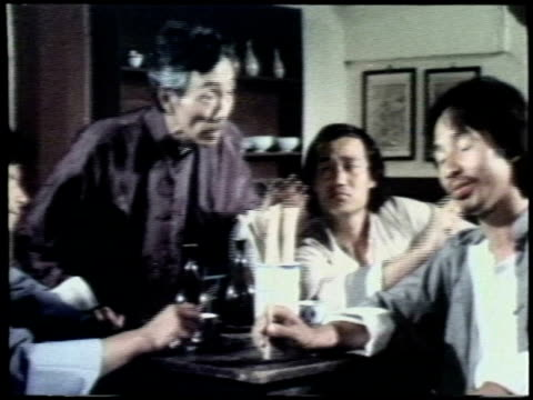 restaurant man is accused of paying for his meal with fake money he is attacked and fights his way out martial arts fight sequence on january 01 1980... - カンフー点の映像素材/bロール