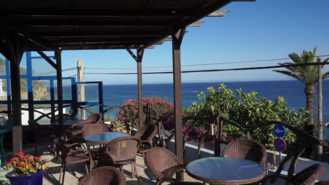 restaurant near of idyllic beach in summer - pavement cafe stock videos & royalty-free footage